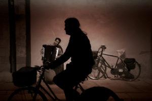 Man riding bike in Italy